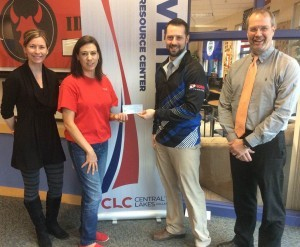 "Sara Spaeth and Theresa Harsha with the Central Lakes College Veterans Resource Center, accept a donation from the Sunrise Sertoma Club. Club members David Quisberg and Jeff Hilborn presented the check for 100% of the funds donated as part of the 2015 ""Joe of GI's"" fund raiser. In addition to the monetary contribution, over 200 vouchers for a free cup of coffee were donated to the Veterans Resource Center."